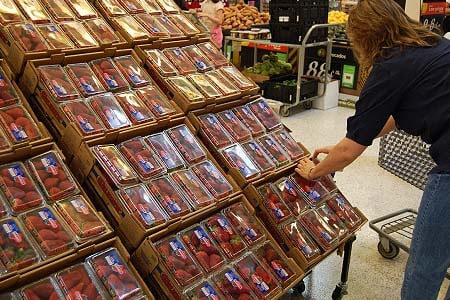 person shopping for strawberries